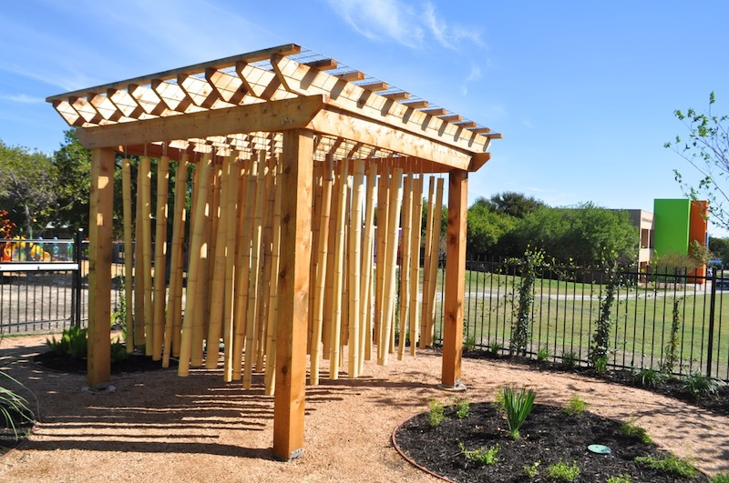 """""""Therapeutic bamboo"""" installation at the Harvey E. Najim Hope Center allows children to literally control their surroundings when amid the hanging bamboo. Photo by Iris Dimmick."""