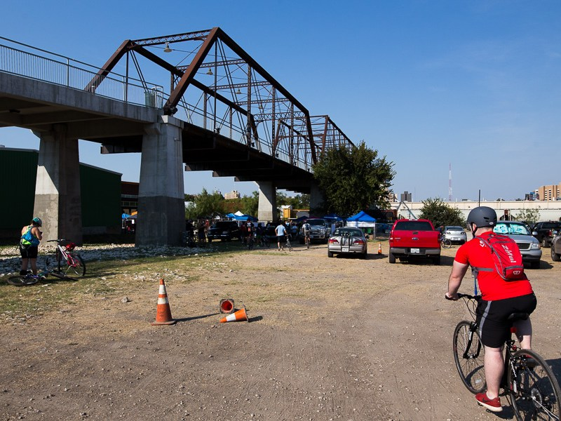A cyclist approaches the Hays Bridge after riding 22 miles. Photo by Scott Ball.