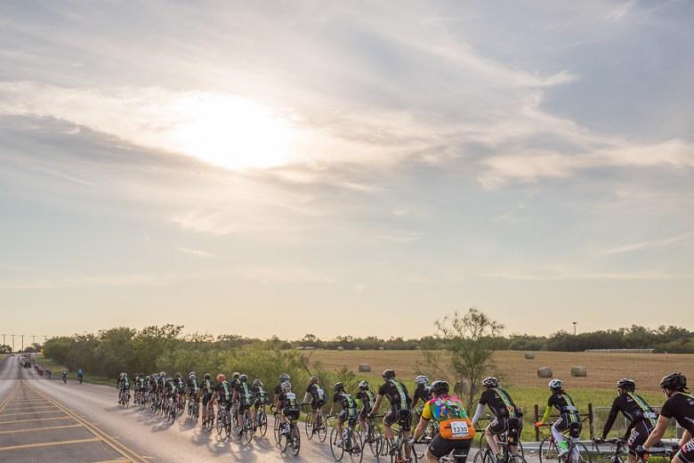 Cyclists pass through farm land just outside of San Antonio. Photo by Scott Ball.