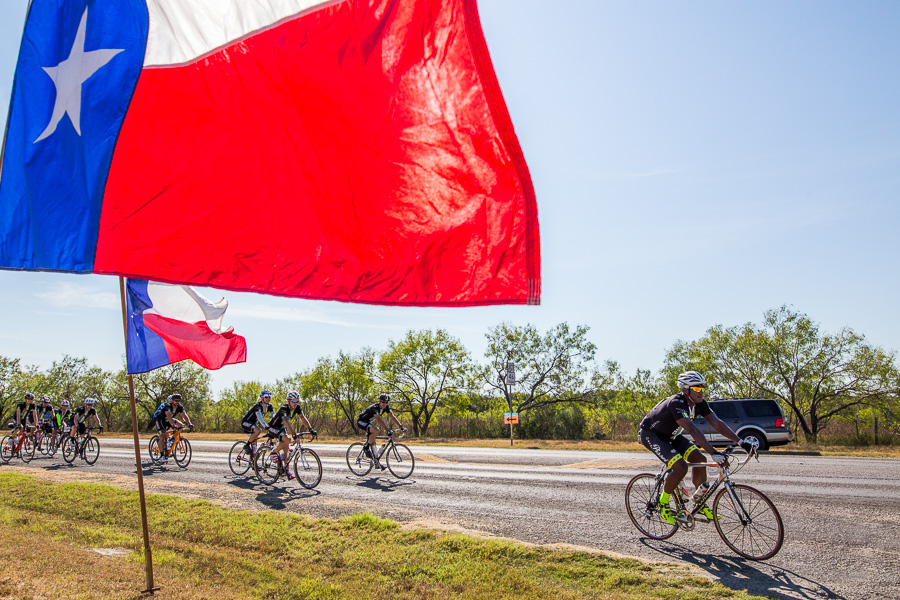 Texas flags wave as the grackles arrive for lunch. Photo by Scott Ball.