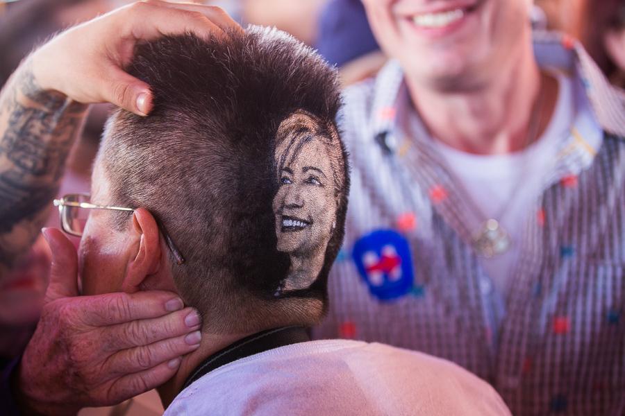 Maria Anita Monsivaiz had her head shaven by local barber Rob the Original. Photo by Scott Ball.