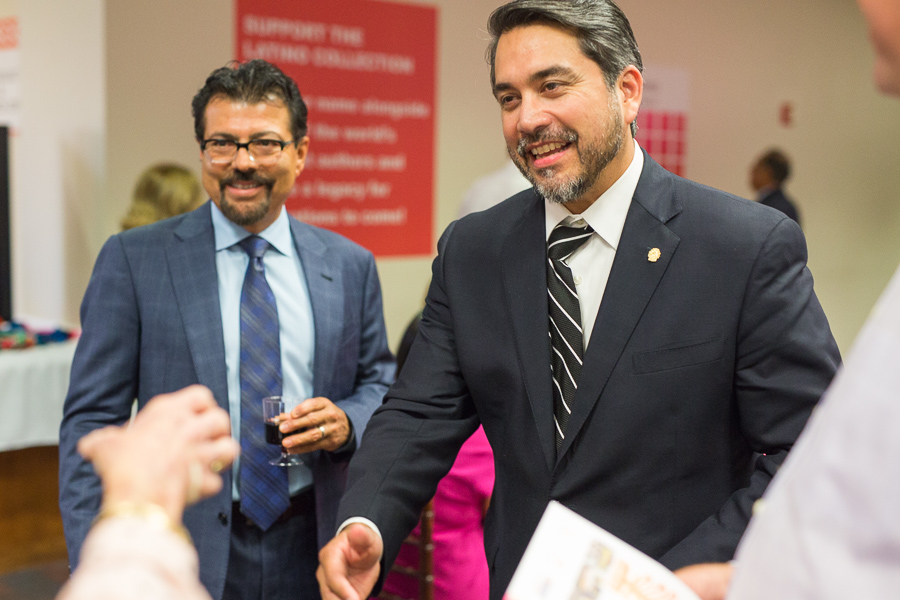 District 1 Councilmember Roberto C. Treviño meets and greets guests with SAPL Director Ramiro Salazar. Photo by Scott Ball.