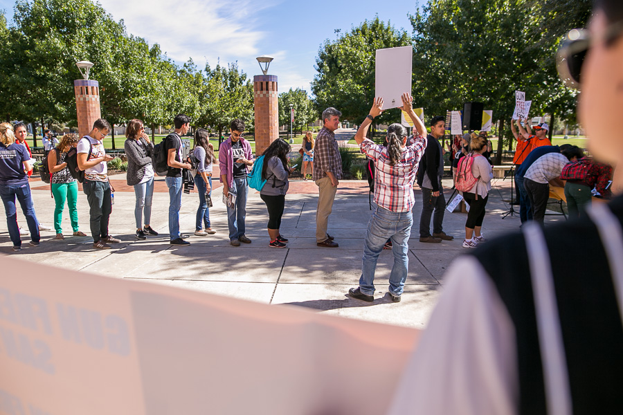 UTSA faculty and students wait in line to sign a petition against campus carry. Photo by Scott Ball.