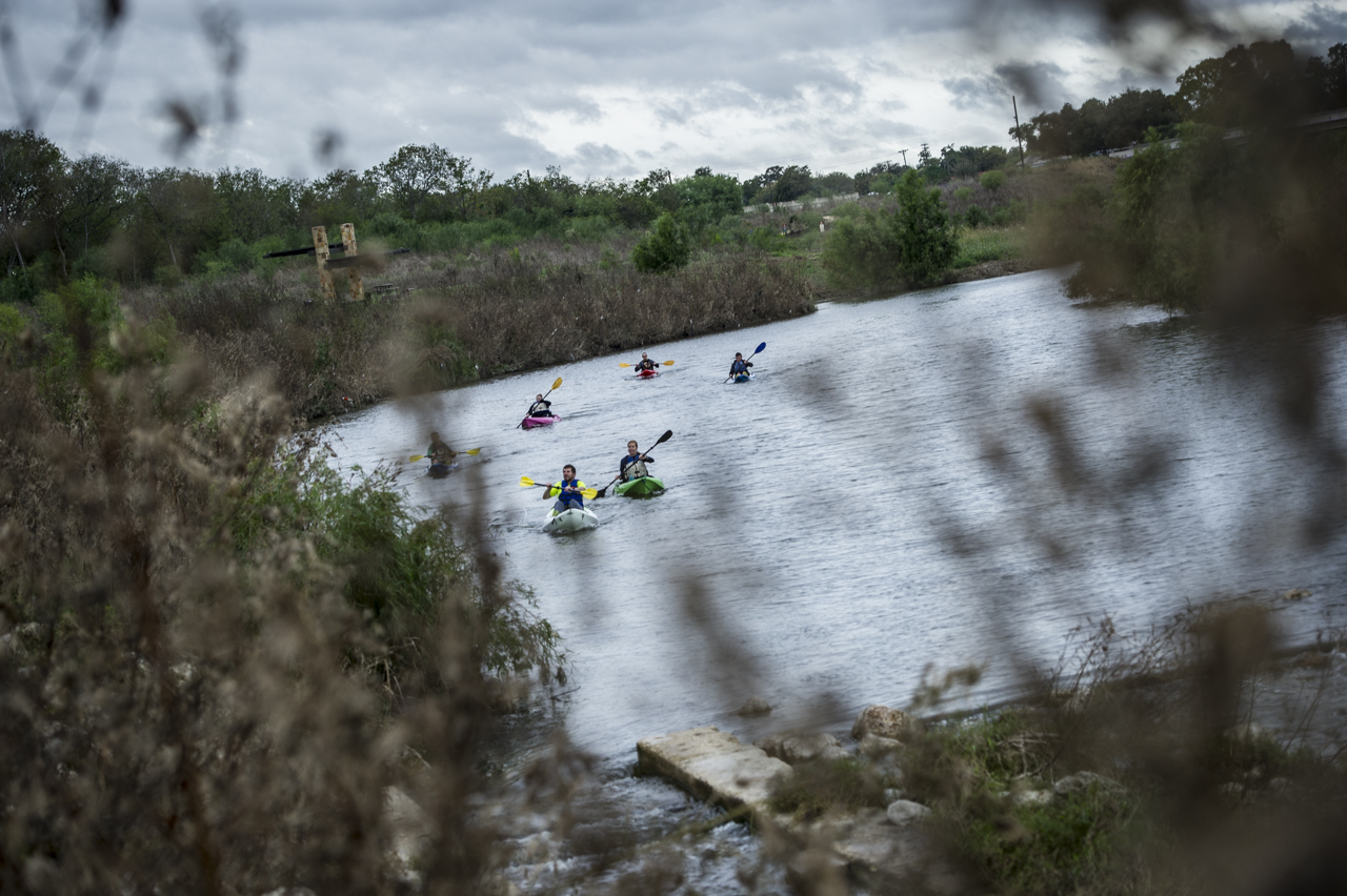 Kayakers paddle to the finish of the river portion of the River Relay. Photo by Matthew Busch.