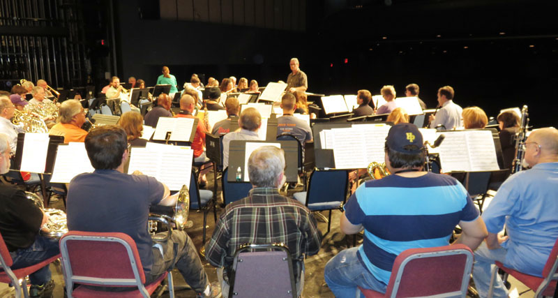 Members of the Heart of Texas Concert Band listen to Conductor Mark Rogers. Photo by Warren Lieberman.