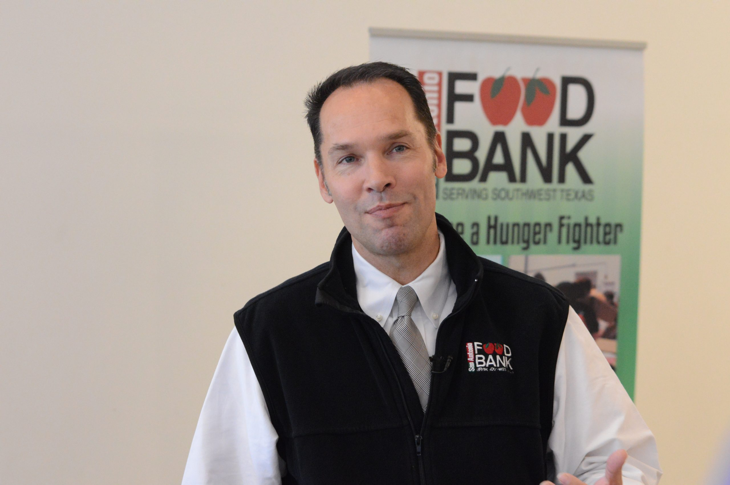 Eric Cooper, president and CEO for the San Antonio Food Bank, asks the community to help donate an additional 9,000 turkeys needed for needy families during Thanksgiving. Photo by Lea Thompson.