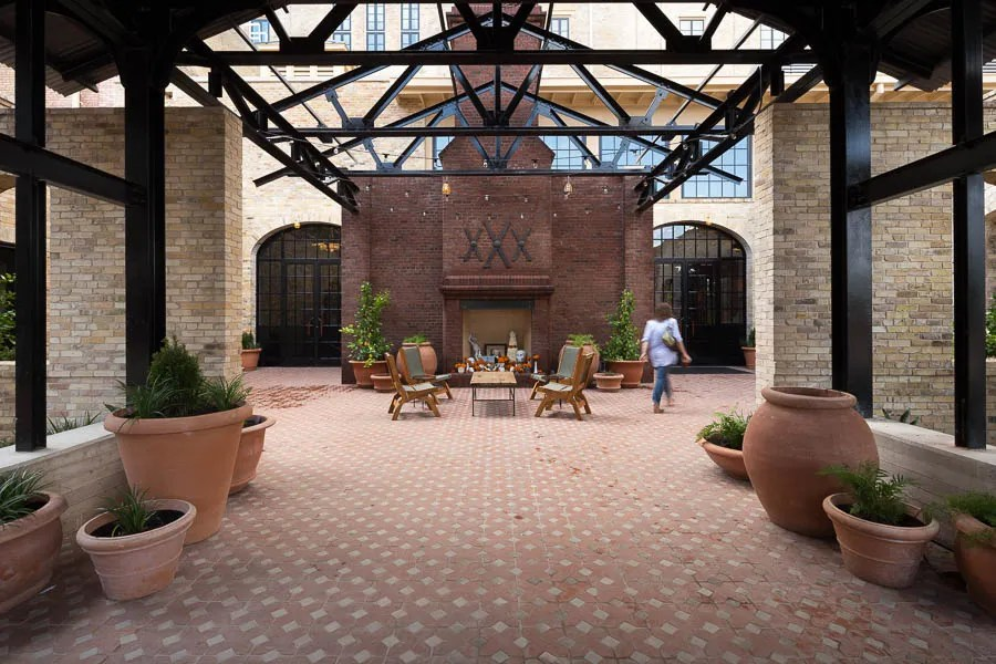 The main entrance with fireplace at Hotel Emma. Photo by Scott Martin.