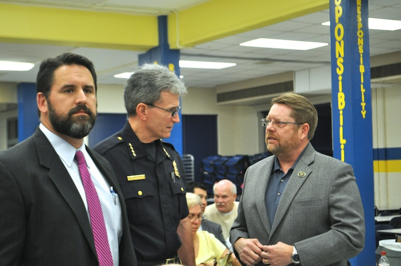 Deputy City Manager Erik Walsh, SAPD Chief William McManus, and SAPOA President Mike Helle stand together before the neighborhood forum. Photo by Iris Dimmick.