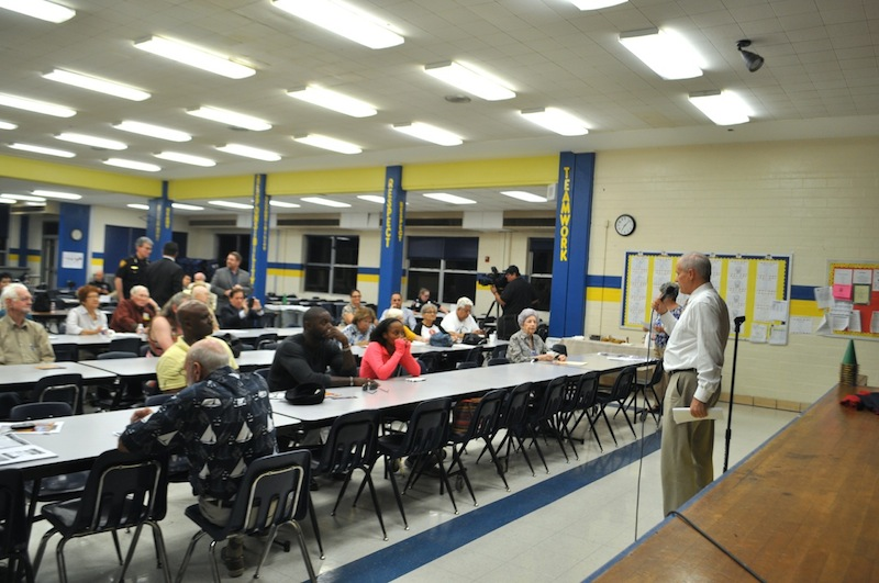 Tommy Adkisson addresses the crowd of about 30 people that gathered for the neighborhood forum. Photo by Iris Dimmick.