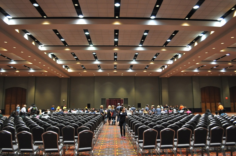 Volunteers gather in separate ballroom to receive their assignments. Photo by Iris Dimmick.