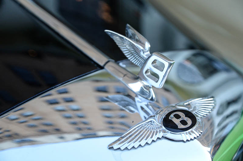 The St. Anthony Hotel is reflected on the hood of a classic Bentley. Photo by Annette Crawford.