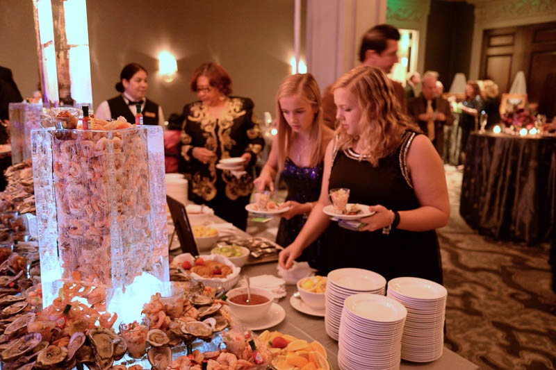 Guests enjoy shrimp and oysters in the Draper Room during the grand opening celebration at the St. Anthony Hotel, Nov. 19, 2015. Photo by Annette Crawford