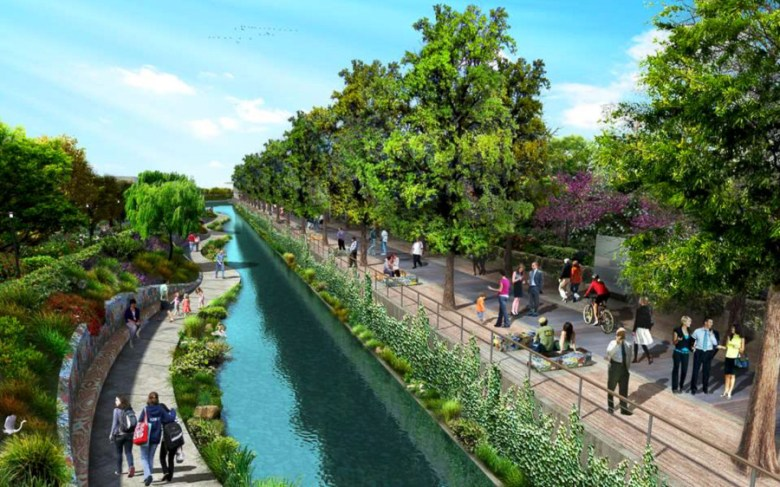 Another view of of San Pedro Creek downtown with added landscaping in the  creek and along a retaining wall with shaded seating, and a wider, tree-lined elevated walkway. Image courtesy of Muñoz & Co.