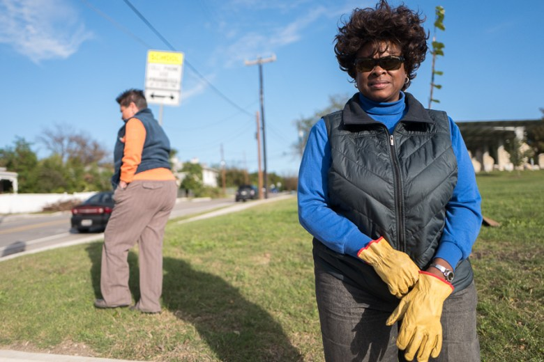 Dignowity Hill Neighborhood Association President Dee Smith puts on her gloves at Lockwood Park. Photo by Scott Ball.