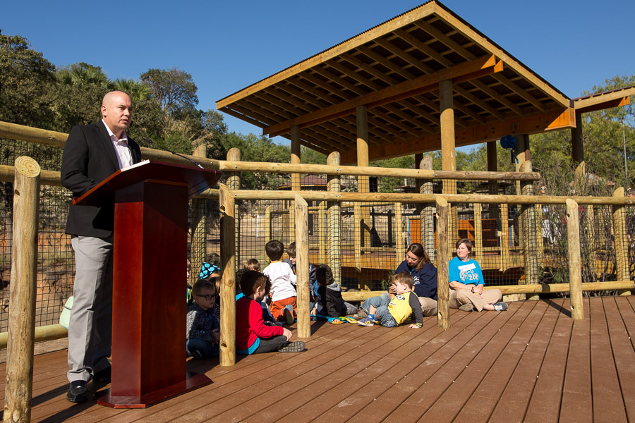 San Antonio Zoo Executive Director Tim Morrow gives opening remarks at the new interactive giraffe exhibit. Photo by Scott Ball.