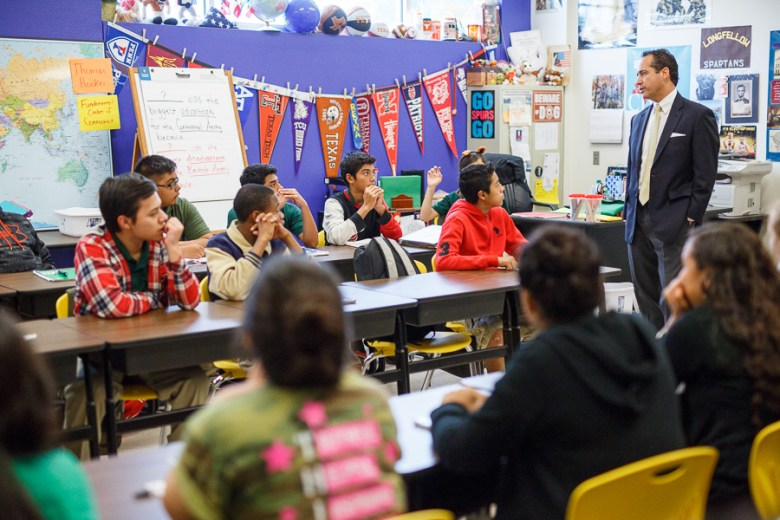 Senator José Menéndez speaks to students in the classroom at Longfellow Middle School. Photo by Scott Ball.
