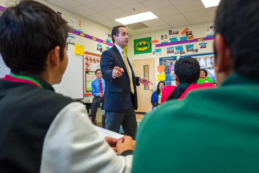 Senator José Menéndez asks students for questions at Longfellow Middle School. Photo by Scott Ball.