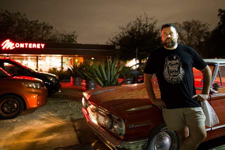 Owner Chad Carey poses for a photo in front of his restaurant, The Monterey. Photo by Scott Ball.