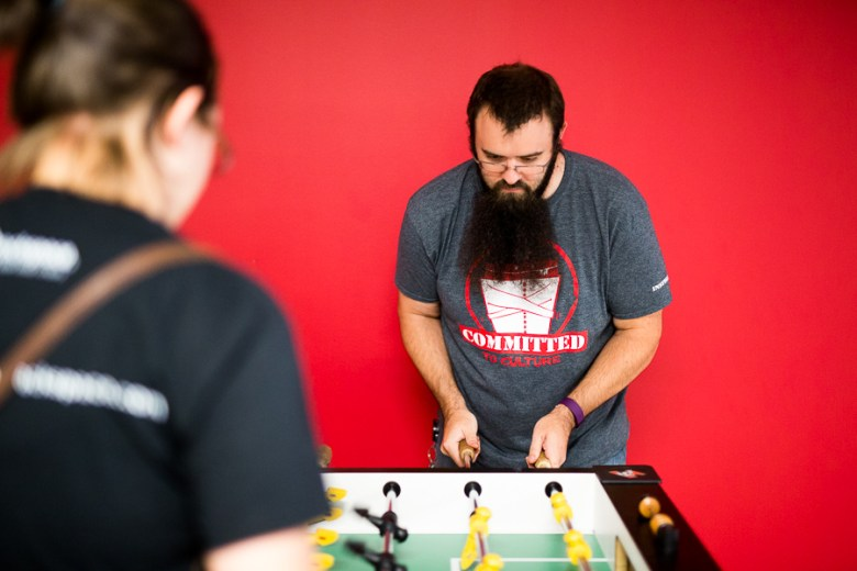 Rackspace employee Marc Lecanu plays foosball with a co-worker. Photo by Scott Ball.
