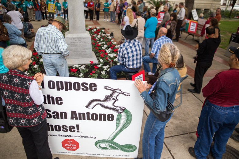 Protesters stand in front of City Hall opposing the Vista Ridge pipeline. Photo by Scott Ball.