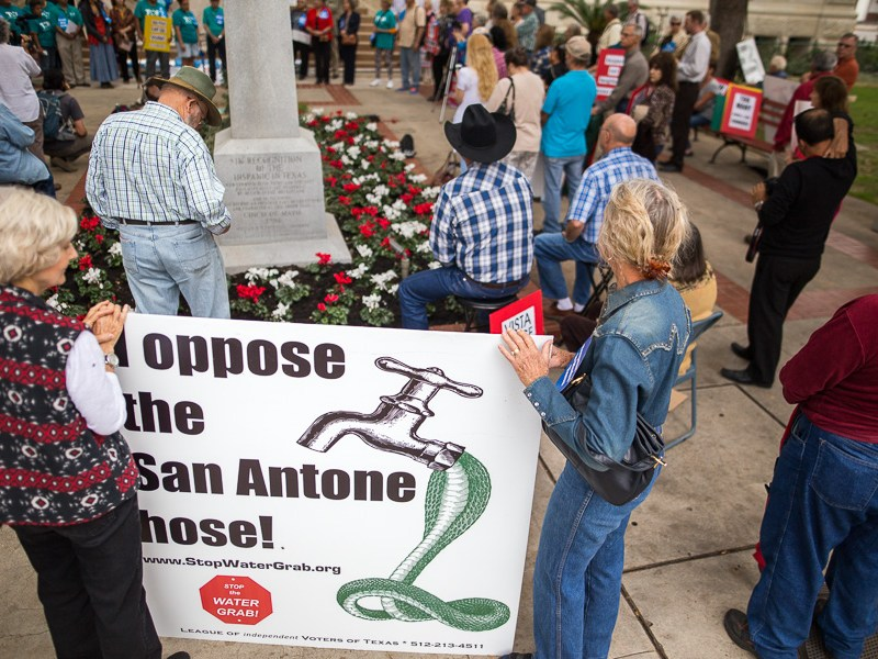 Protestors stand in front of City Hall opposing the Vista Ridge pipeline. Photo by Scott Ball.