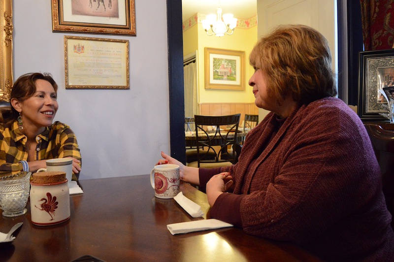 Councilmember Shirley Gonzales (left) speaks with former Sen. Leticia Van de Putte about the tragic loss of children to SIDS. Photo by Lea Thompson.