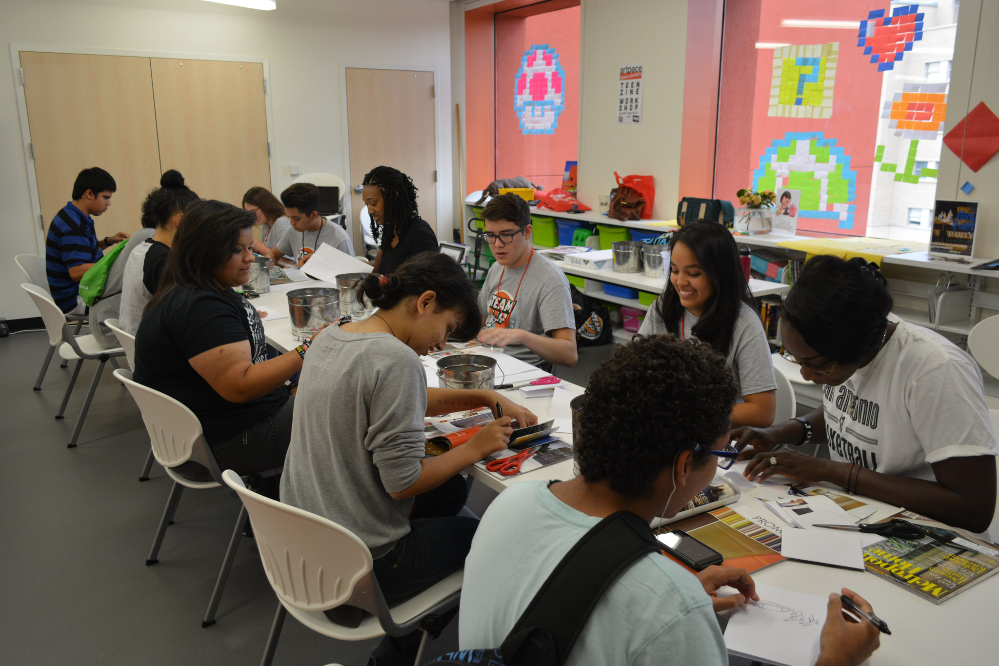 eens participate in zine making (magazine making) with staff from ArtPace. Photo by 210TeenLibrary.