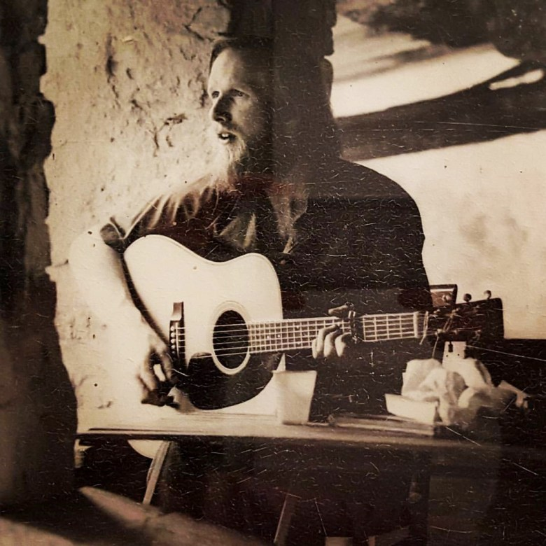 Dennis Olsen playing guitar at his Tuscany farmhouse in the 1970's. Photo courtesy Erik Olsen.