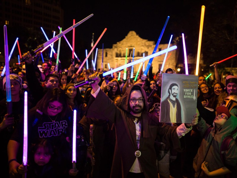 Man pays tribute to Daniel Fleetwood, a 32 year old Texas man who was granted his dying wish to see Star Wars Episode 7: The Force Awakens at Alamo Plaza. Photo by Michael Cirlos.