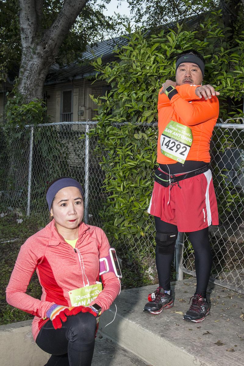 Runners stretch before starting the San Antonio Rock 'N' Roll Marathon. Photo by Matthew Busch.