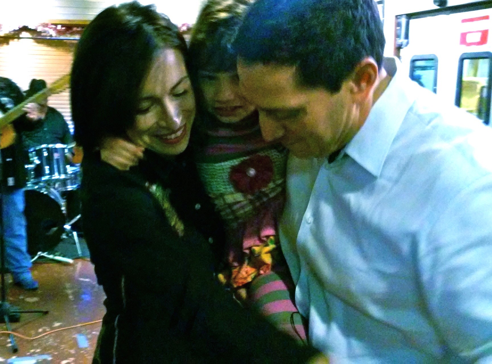 State Rep. Trey Martinez Fischer (D-116) dances with wife Elizabeth and daughter Camilla after announcing his run for the state Senate District 26 seat at Henry's Puffy Tacos on Sunday, Dec. 13, 2015. Photo by Edmond Ortiz