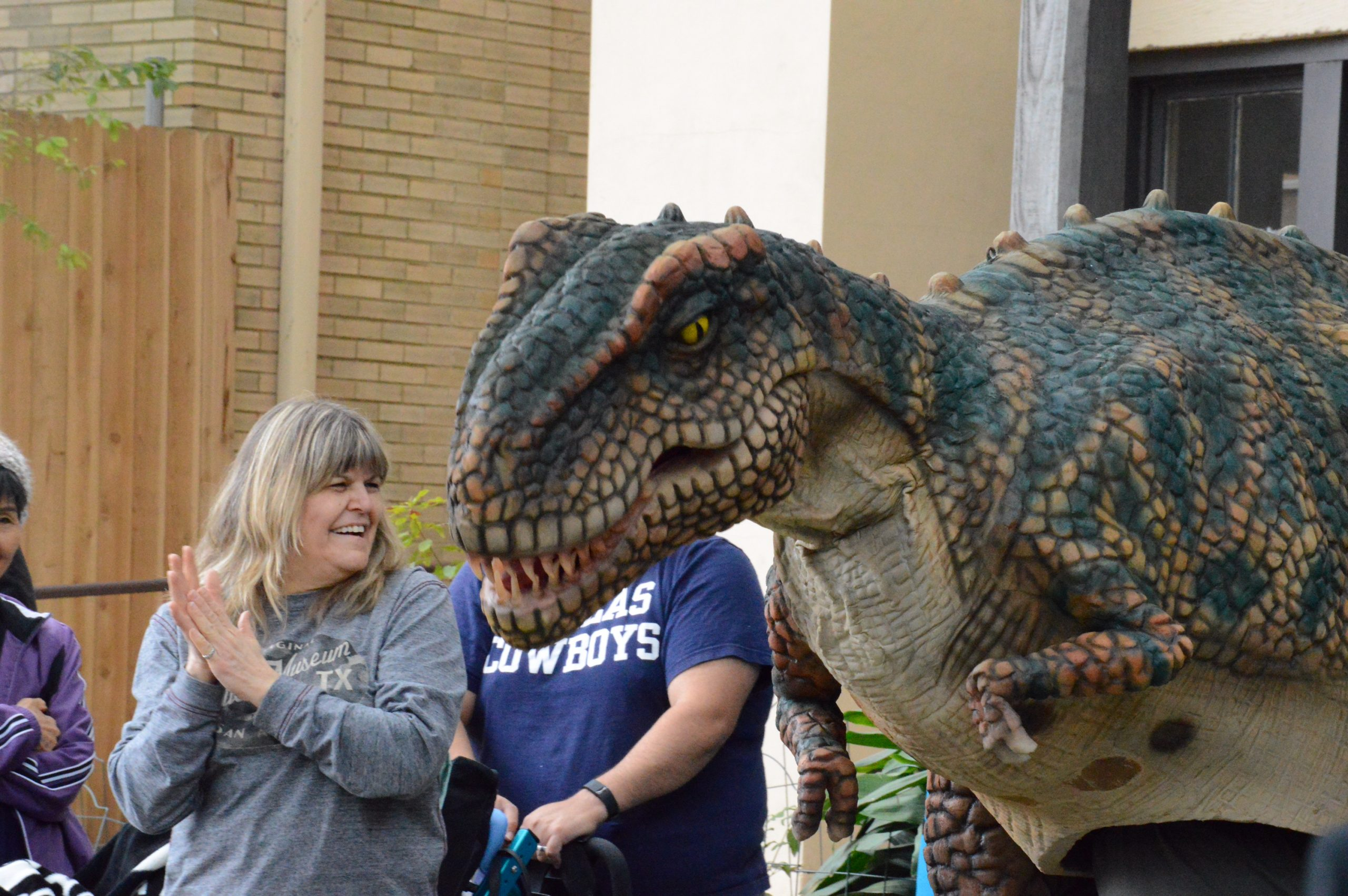 Museum members welcome the dinosaur representative from the new Naylor Family Dinosaur Gallery at the Witte. Photo by Lea Thompson.