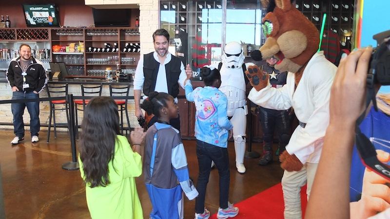 "Councilman Roberto ""Han Solo"" Treviño (D1) greets children at Alamo Drafthouse. Photo by Abbey Francis."