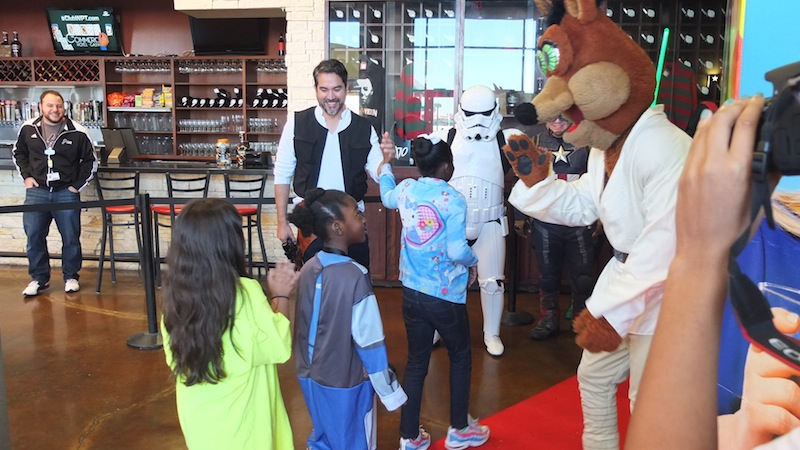 "Councilman Roberto ""Han Solo"" Treviño (D1) greets children at Alamo Drafthouse. Photo by Abbey Francis."
