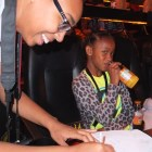 A young member of the Boys and Girls Club strikes a pose as District 1 aide Desiree Luckey signs her autograph. Photo by Abbey Francis.