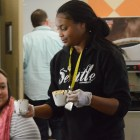Denesha Ketchum serves 'Hot Chocolate S'mores' to event attendees on Dec. 4, 2015. Photo by Lea Thompson.
