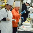 Culinary program graduate Karla Saenz listens to Chef Jill Jurkow on graduation day. Photo by Lea Thompson.