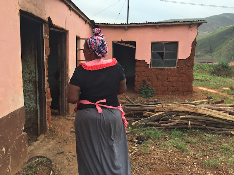 Thembile walks from the main house to the kitchen. Photo by Casey Miller.
