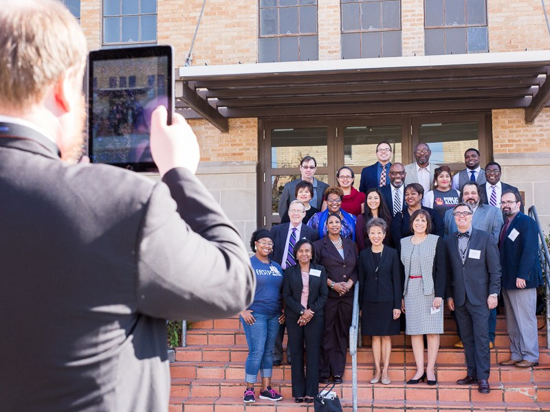 City officials, NEA representatives, and community members pose for a group photo on the steps of the Carver Community Cultural Center. Photo by Scott Ball.