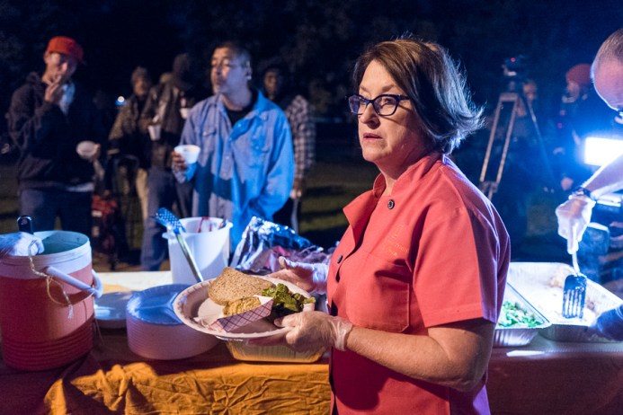 Joan Cheever of The Chow Train prepares a plate for someone in need. Photo by Scott Ball.