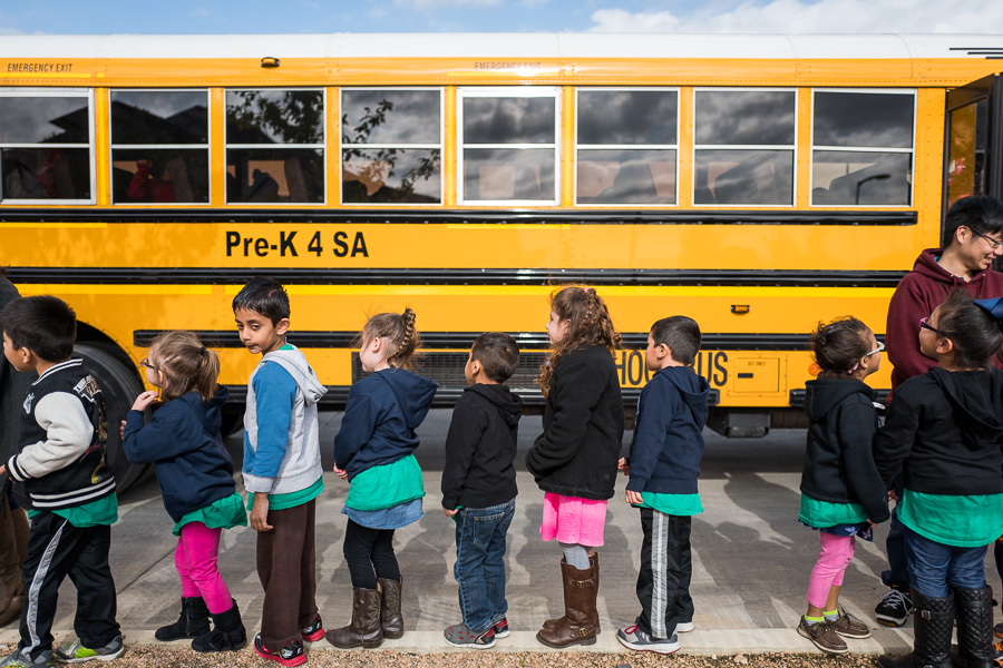 Pre-K 4 SA students line up outside of their bus at the San Antonio Food Bank. Photo by Scott Ball.