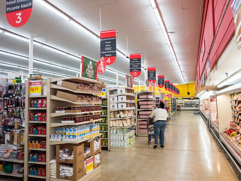 A customer walks the aisles in the back of H-E-B. Photo by Scott Ball.
