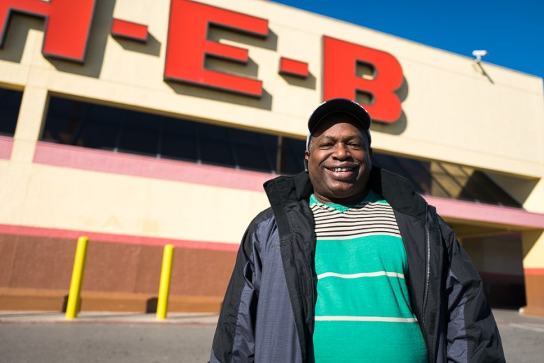 John Calloway poses for a photo in front of his local H-E-B located in the cities near East side. Photo by Scott Ball.