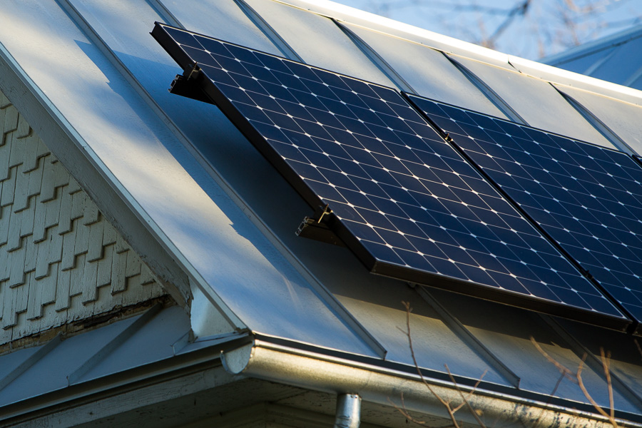 A residential house with installed solar panels on the cities East side. Photo by Scott Ball.