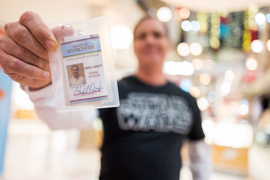 Shops at Rivercenter General Manager Chris Oviatt displays his badge verifying that he is indeed the General Manager at the Shops at Rivercenter. Photo by Scott Ball.
