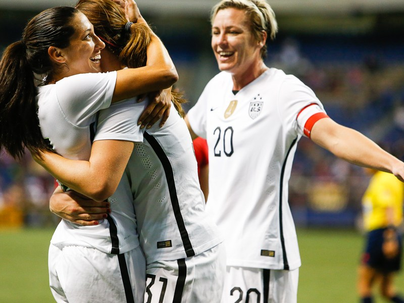 Christen Press (left) celebrates with Lindsey Horan (middle) and Abby Wambach after scoring a goal. Photo by Scott Ball.