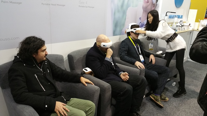 """Lucky attendees get their eyes """"massaged"""" with the BREO iSee 4 Eye Massager, developed by a Chinese company, during the 2016 International Consumer Electronics Show. Photo by Ben Tovar."""