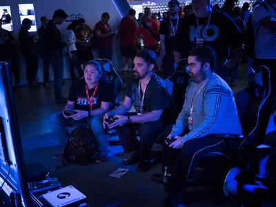 Gaming enthusiasts try out Intel's both featuring DX Racer chairs and Alienware PCs. Photo by Kathryn Boyd-Batstone