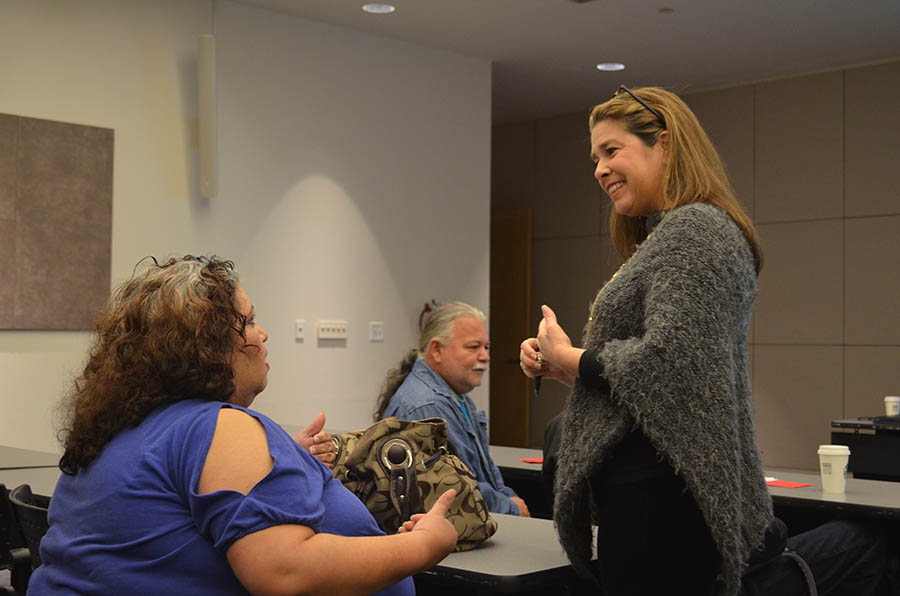 President of the Canary Islands Descendants Association Mari Tamez talks with a workshop attendee. Photo by Camille Garcia.