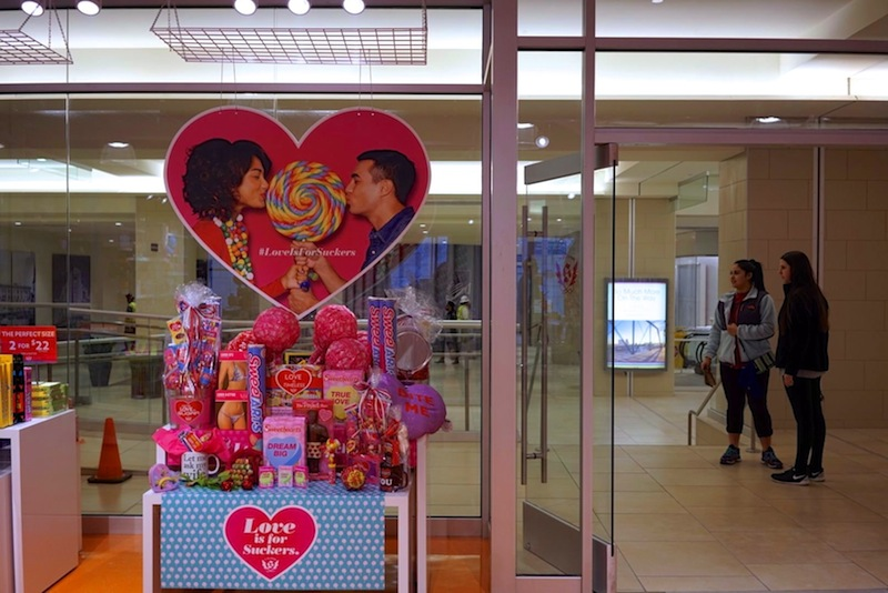Two young women stand outside of It's Sugar, a new candy story in the Rivercenter Mall located in the former Joske's Building. Photo by Iris Dimmick.